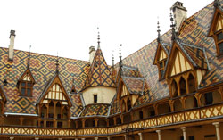 Photograph of the multi-coloured tiled slate roof of the Musee de l'Hotel-Dieu in Beaune, France. Photo taken by Danielle MacDonald