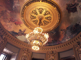 Photograph of the chandelier and painted ceiling of the Salon Glaicer in Paris's Palais Garner. Photo by Danielle MacDonald